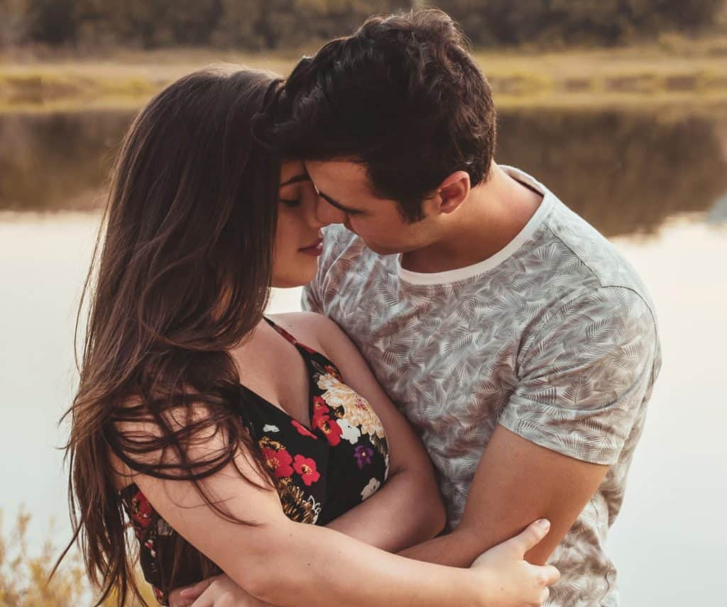 romantic couple kissing and enjoying the physical connection. Showing true emotions is important to make someone fall in love.