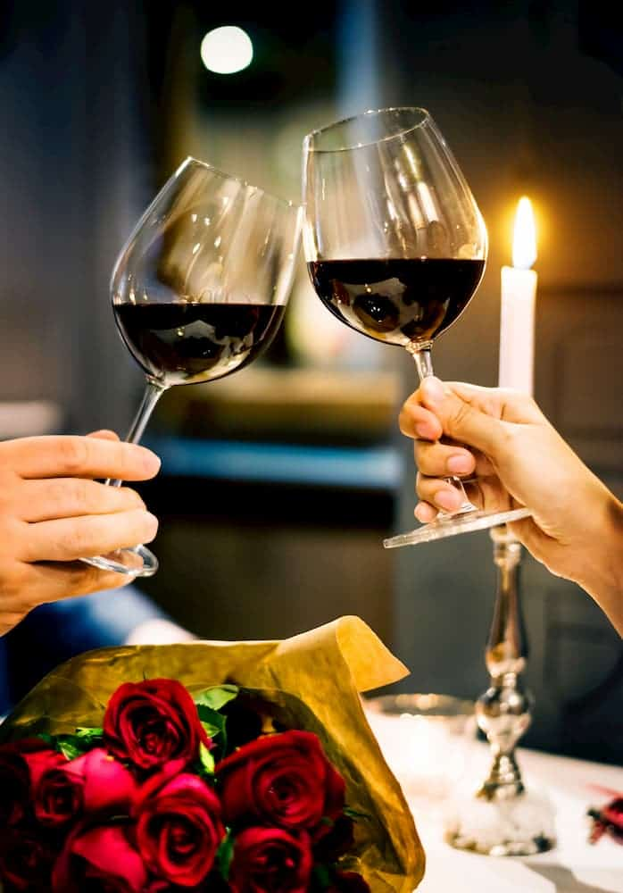 reconcile with significant other. Two lovers toasting with wine glasses