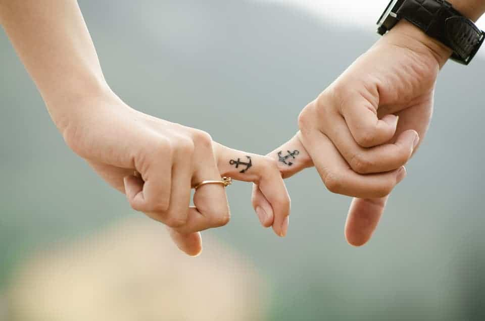 Save a relationship from breakup. Couple holding fingers