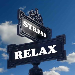 stress and relax signs in a road