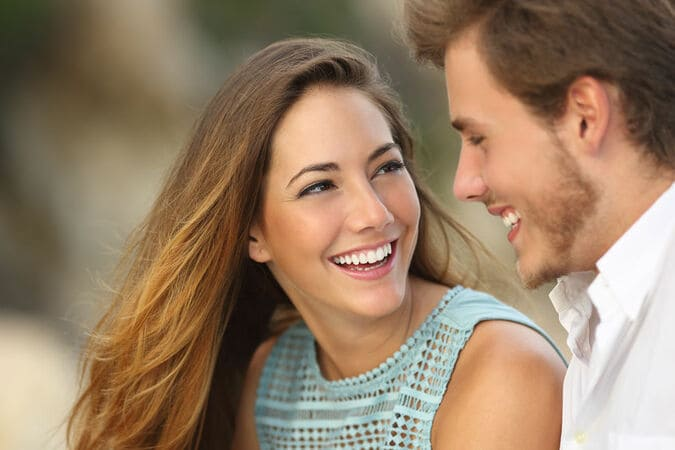 Happy couple smiling because love spell got them back together. White magic spells for love.