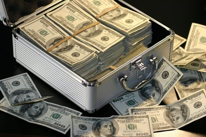 Box full of money created by money spells. Wealth spells may bring in money and lottery wins.