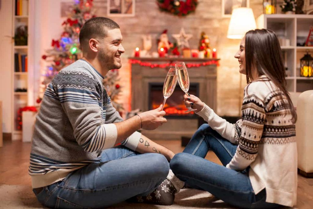 couple celebration holidays with a glass of wine
