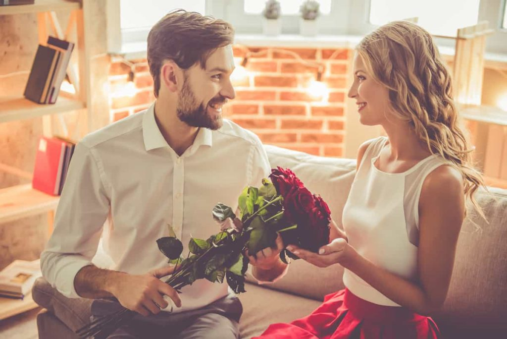 boyfriend gifting flowers to his girlfriend