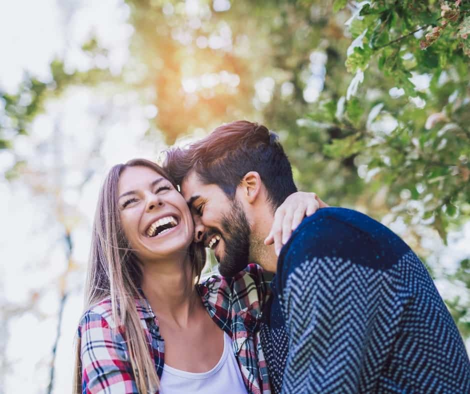 couple hugging each other and laughing