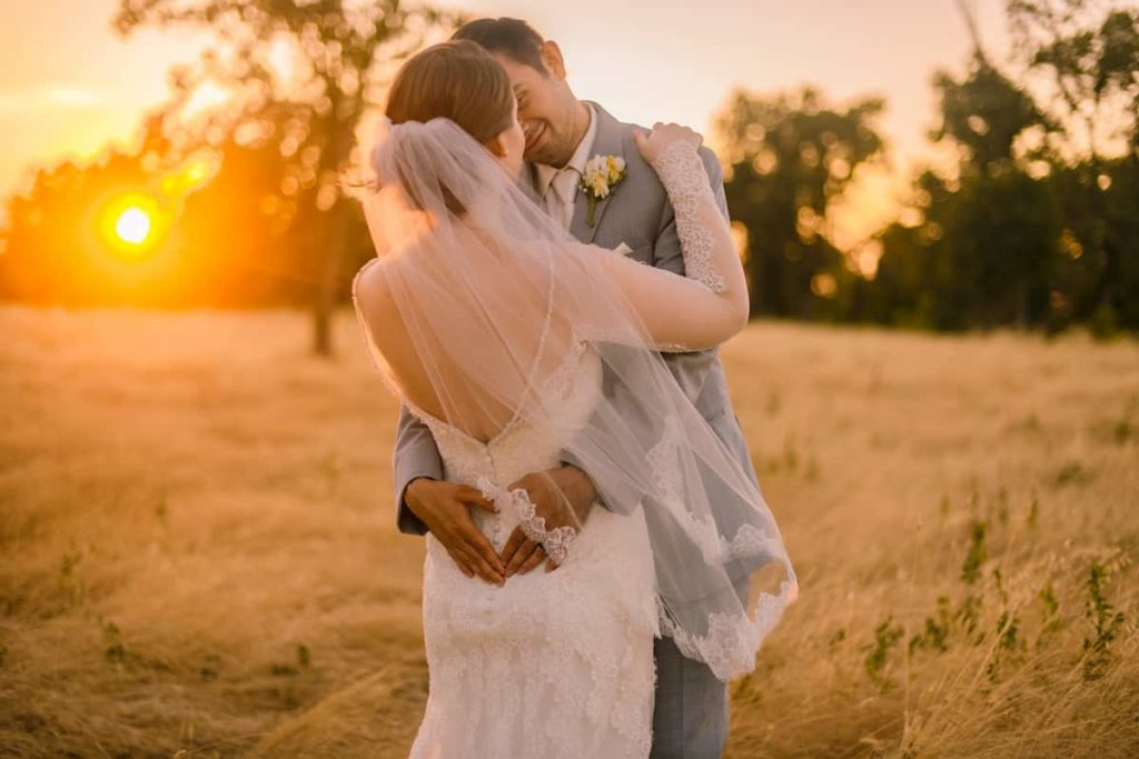 man and woman getting married at sunset