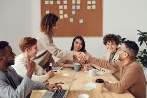 Aries-woman-and-Virgo-man: office members in a jovial office meeting