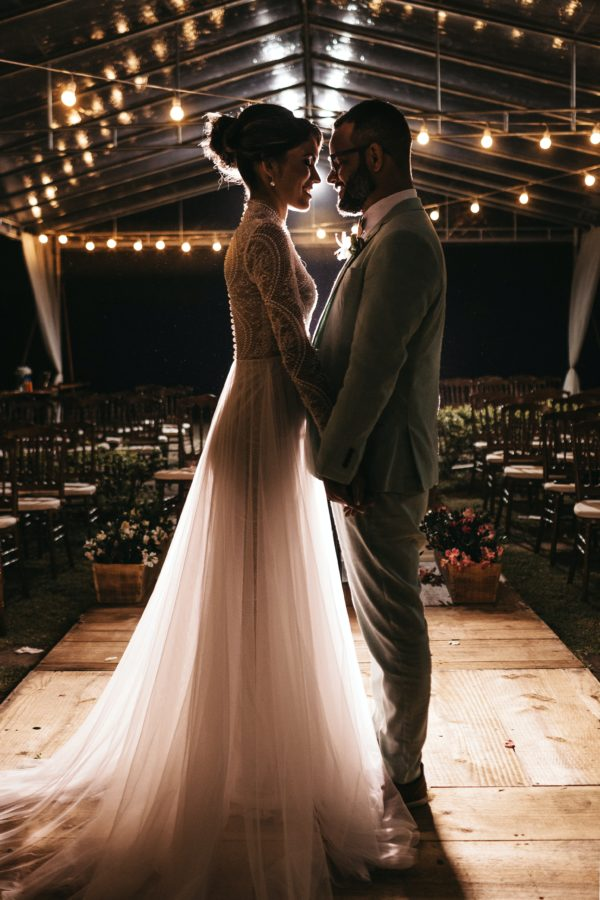 Cancer-Woman-and-Taurus-Man: couple standing close at the altar