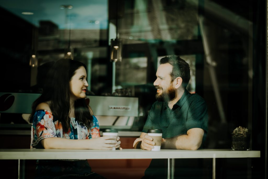 Capricorn-Man-and-Libra-Woman: couple talking over coffee