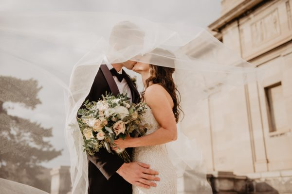 Capricorn-Man-and-Taurus-Woman: couple kissing after getting married