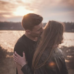 Capricorn and Libra: couple kissing outdoors
