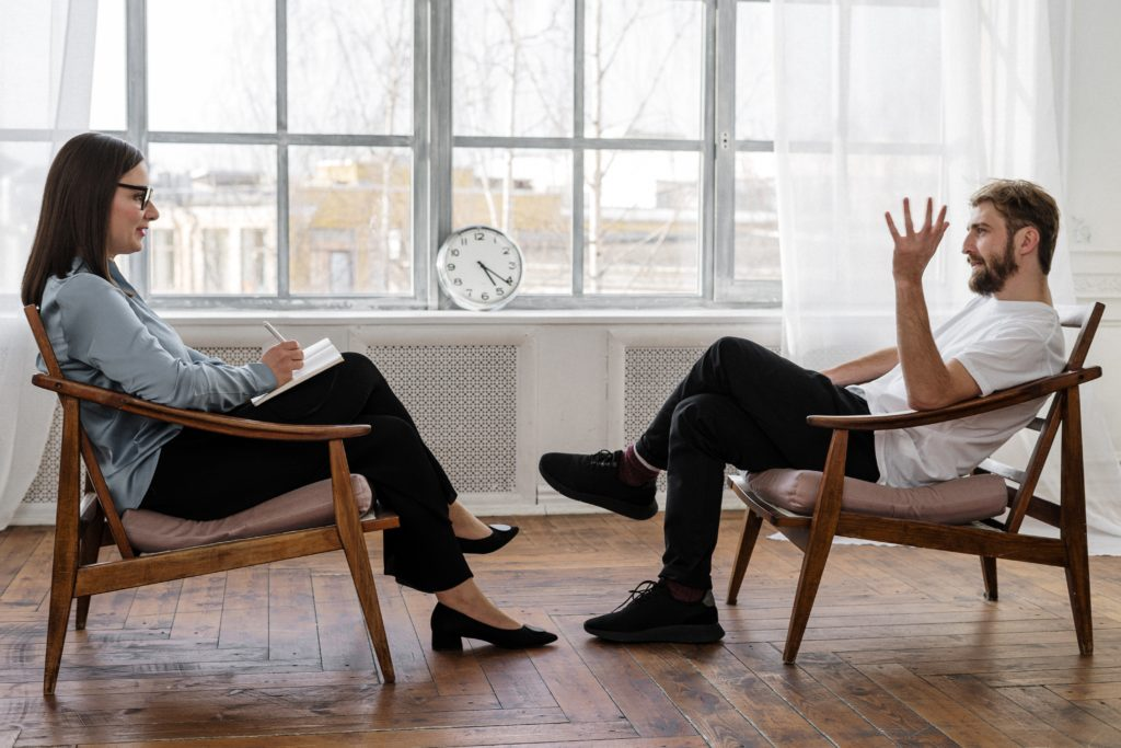 Capricorn-Woman-and-Taurus-Man: couple discussing things seated opposite each other