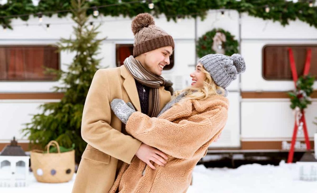 Affectionate Young Couple Hugging And Having Fun Together During Winter Day