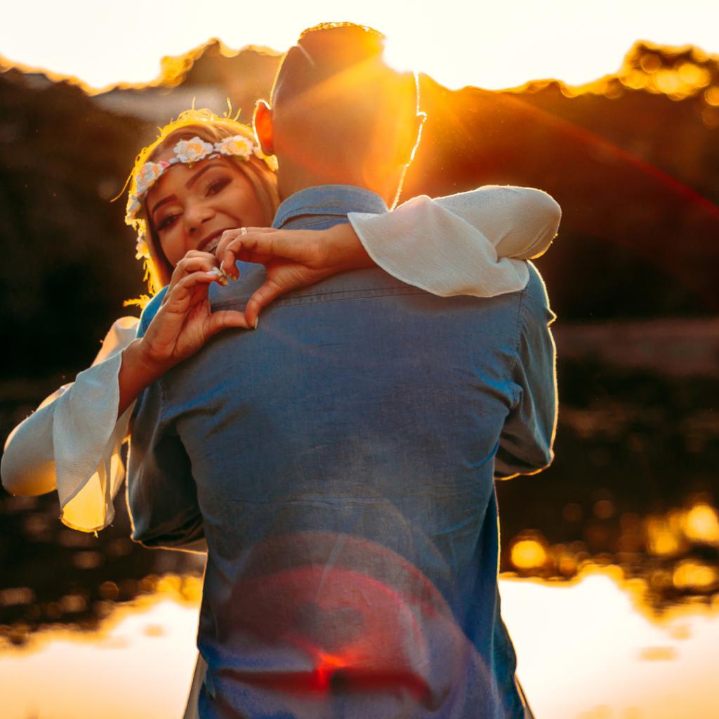 Man And Woman Hugging and enjoying sunset