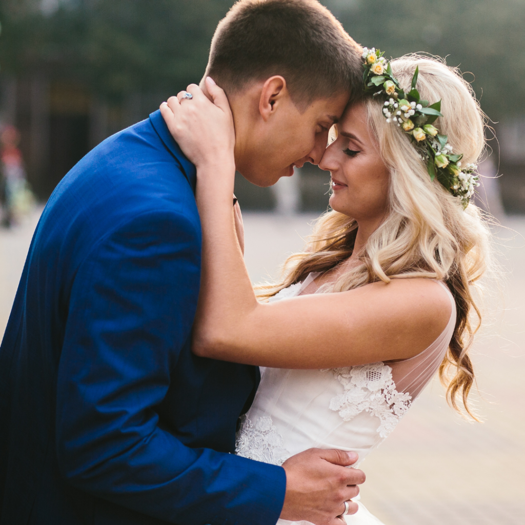 couple hugging while getting married