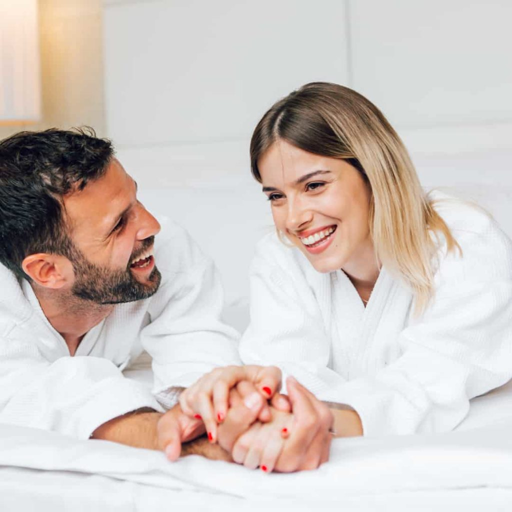 Young couple enjoying each other's company in a hotel room