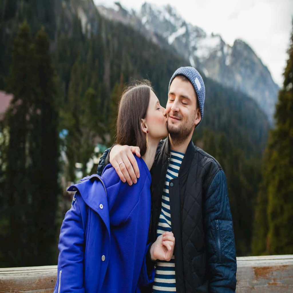 young couple in love on winter vacation in mountains