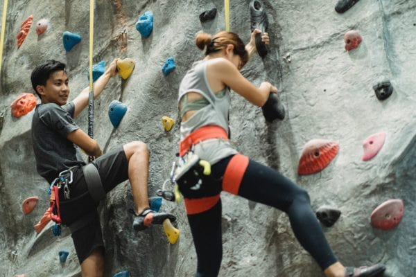 Libra-woman-with-Virgo-man:  couple rock-climbing together