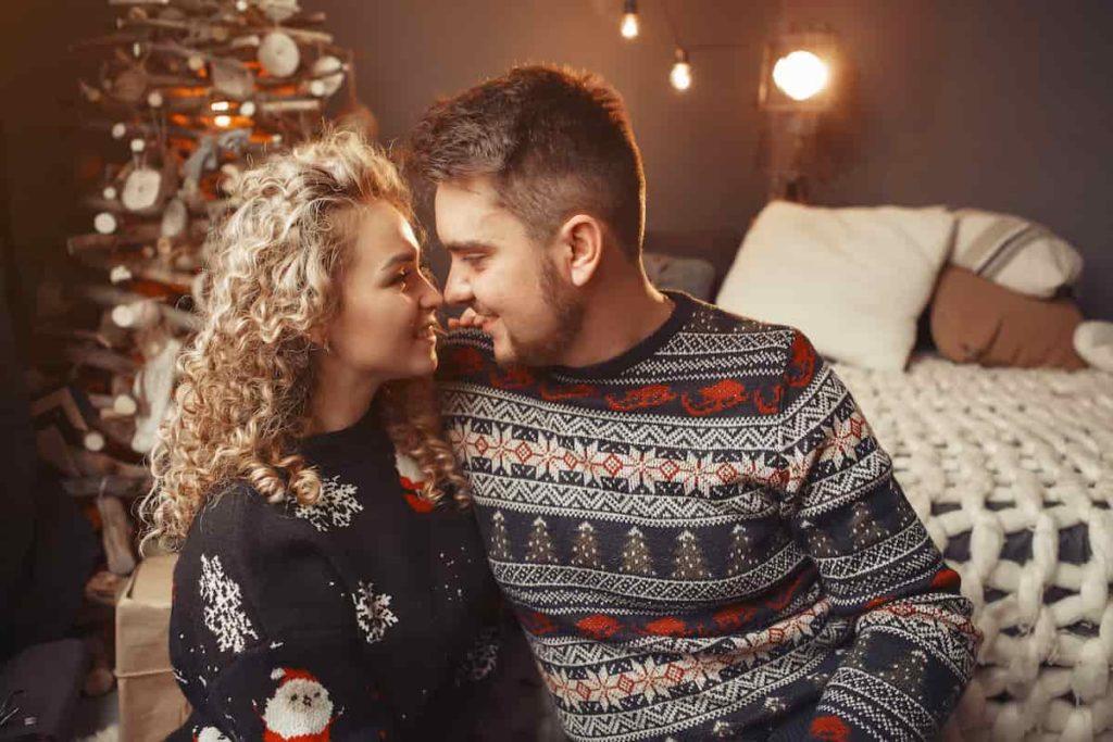 elegant couple sitting at home near christmass tree