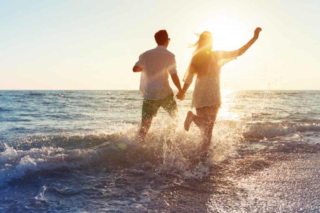 happy young couple enjoying sea