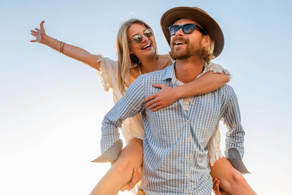 happy man holding woman up
