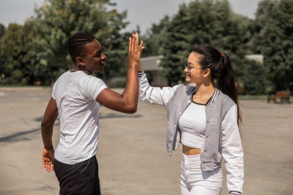 Scorpio-Woman-and-Virgo-Man: couple doing a high-five