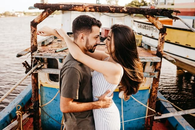 couple looking at each other and smiling in a ship