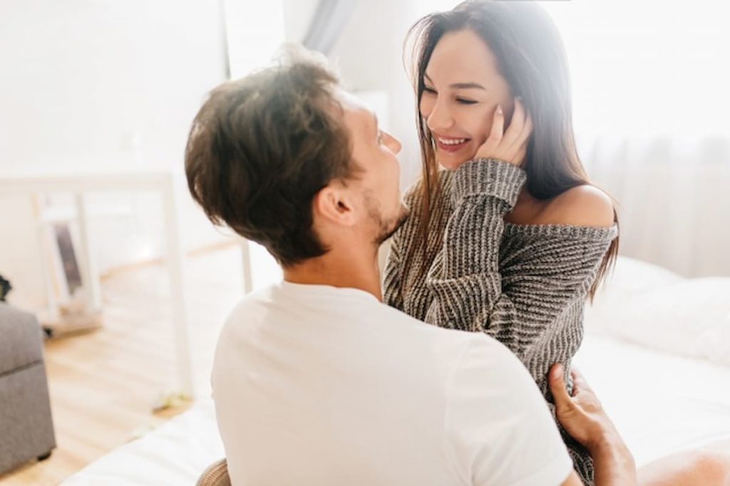 man and woman hugging and laughing