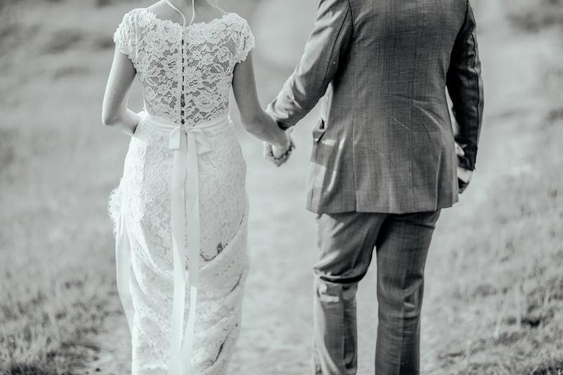 couple walking hand in hand. taurus man and aquarius woman 3