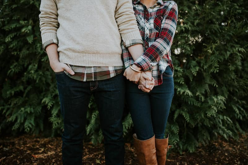Taurus man with Libra woman: Loving couple holding hands