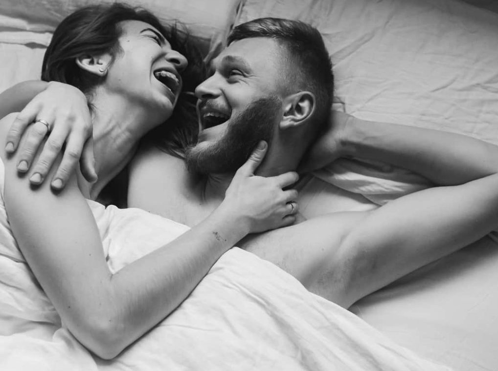Virgo-Woman-and-Cancer-Man: couple laughing in bed