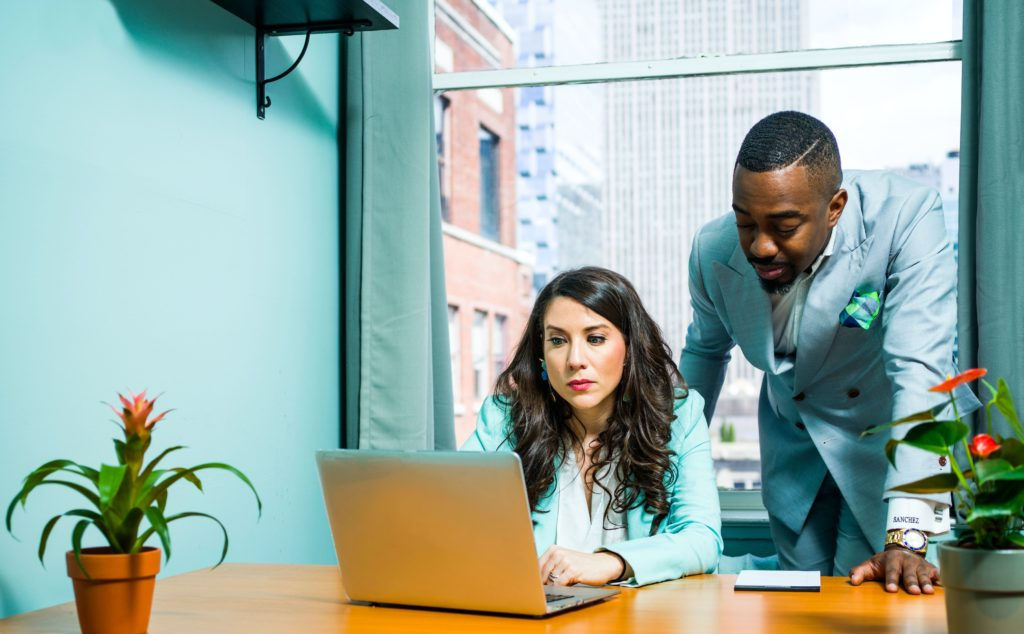 Virgo-Woman-and-Taurus-Man: couple at work in office