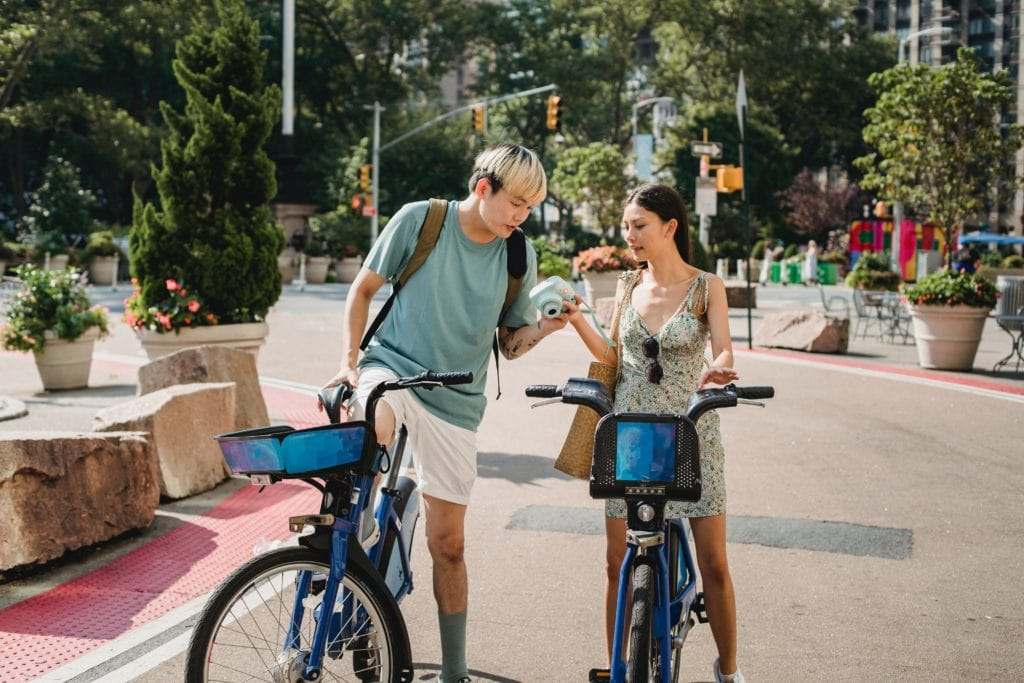 Leo woman and Virgo man: couple cycling outdoors