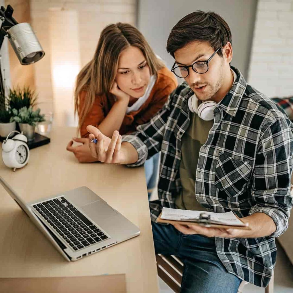 man teaching women while working together at home