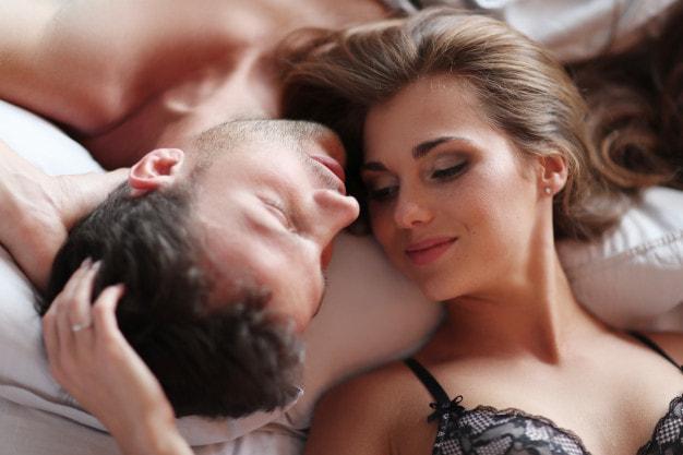 lovely couple lying in bed in underwears