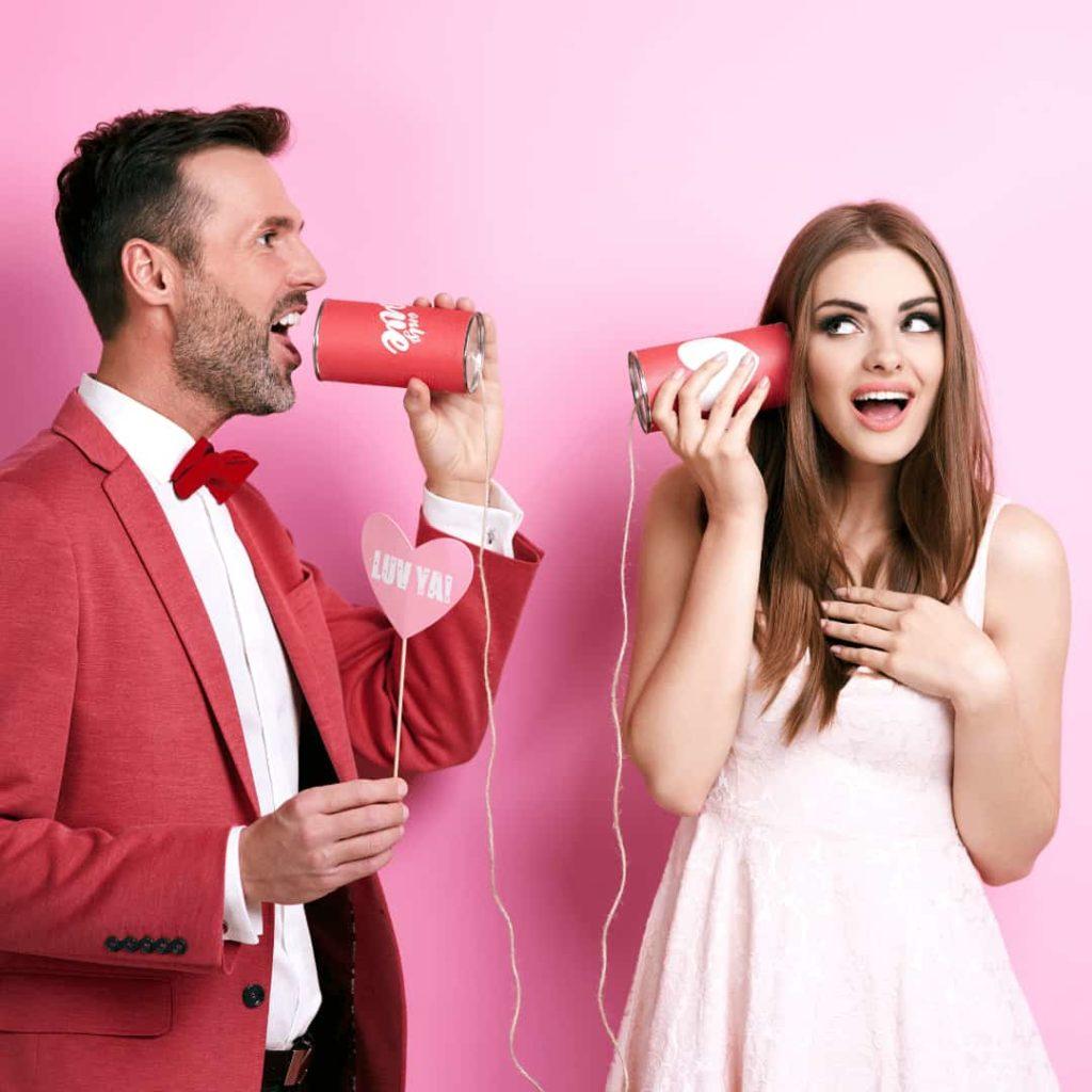 Virgo Man and Aquarius Woman: couple talking on tin can phone