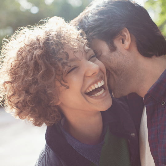 Virgo-Man-with-Pisces-Woman: Close up laughing couple hugging