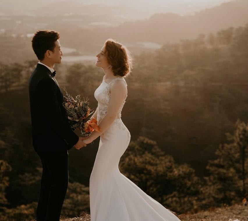 bride standing opposite groom outdoors